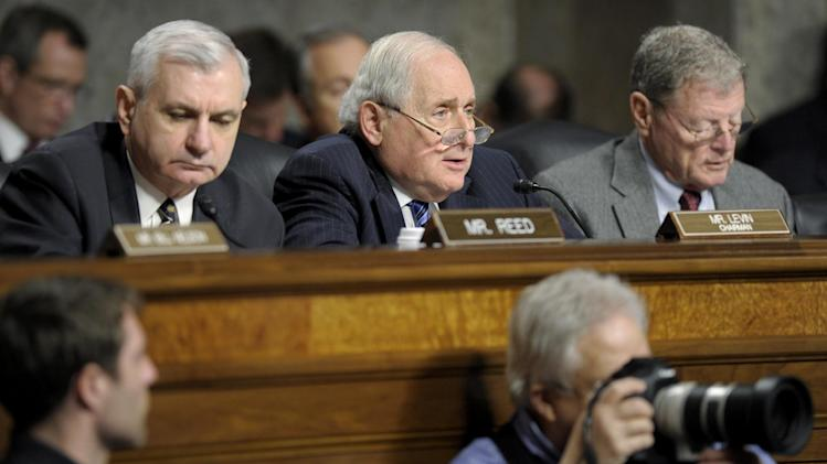 Senate Armed Services Committee Chairman Sen. Carl Levin, D-Mich., center, flanked by Sen. Jack Reed, D-R.I., left, and the committee's ranking Republican Sen. James Inhofe, R-Okla., right, asks a question of former Nebraska Republican Sen. Chuck Hagel, President Barack Obama's choice for defense secretary, on Capitol Hill in Washington, Thursday, Jan. 31, 2013, during the committee hearing on Hagel's nomination.  (AP Photo/Susan Walsh)