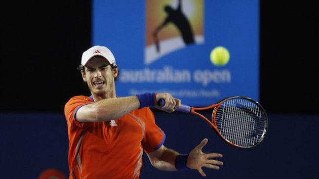 Andy Murray of Britain hits a return to Novak Djokovic of Serbia during their men's singles semi-final match at the Australian Open tennis tournament in Melbourne