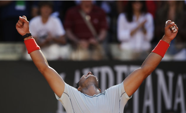 Spain's Rafael Nadal celebrates after defeating Switzerland's Roger Federer at the final match of the Italian Open tennis tournament in Rome, Sunday, May 19, 2013. Nadal won 6-1, 6-3. (AP Photo/Andrew