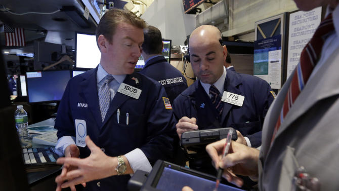 In this Tuesday, April 16, 2013, photo, Specialist Michael O'Mara, left, and trader Fred Demarco work on the floor of the New York Stock Exchange. World stock markets fell Friday April 26, 2013 after Japan faced an unwelcome drop in consumer prices. (AP Photo/Richard Drew)