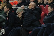 "Arsenal manager Arsene Wenger cuts a frustrated figure as he watches his side in the 3-1 home defeat to Bayern Munich, on February 19, 2013. Wenger admitted his side had been outclassed and said it seemed ""impossible"" to turn the Champions League last 16 tie around"