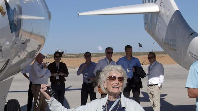 This Oct. 17, 2011 photo shows Eve Branson, mother of British billionaire Sir Richard Branson, posing for photographers beside the spacecraft White Knight Two outside the new Spaceport America hanger in Upham, NM. Branson acknowledges that her family is anxious to see the day when the first rocket takes off from Virgin Galactic's remote desert base at Spaceport America in southern New Mexico.(AP Photo/Matt York, File)