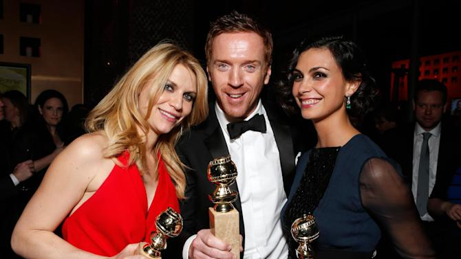 IMAGE DISTRIBUTED FOR FOX SEARCHLIGHT - From left, actors Claire Danes, Damian Lewis and Morena Baccarin attend the Fox Golden Globes Party on Sunday, January 13, 2013, in Beverly Hills, Calif. (Photo by Todd Williamson/Invision for Fox Searchlight/AP Images)