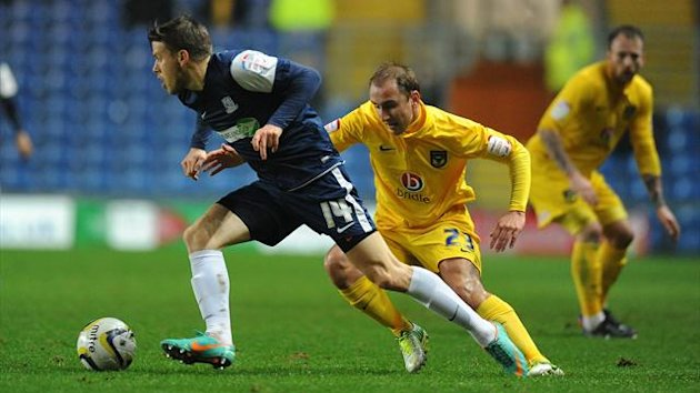 Oxford United's Luke O'Brien and Southend United's Kevan Hurst (PA Photos)