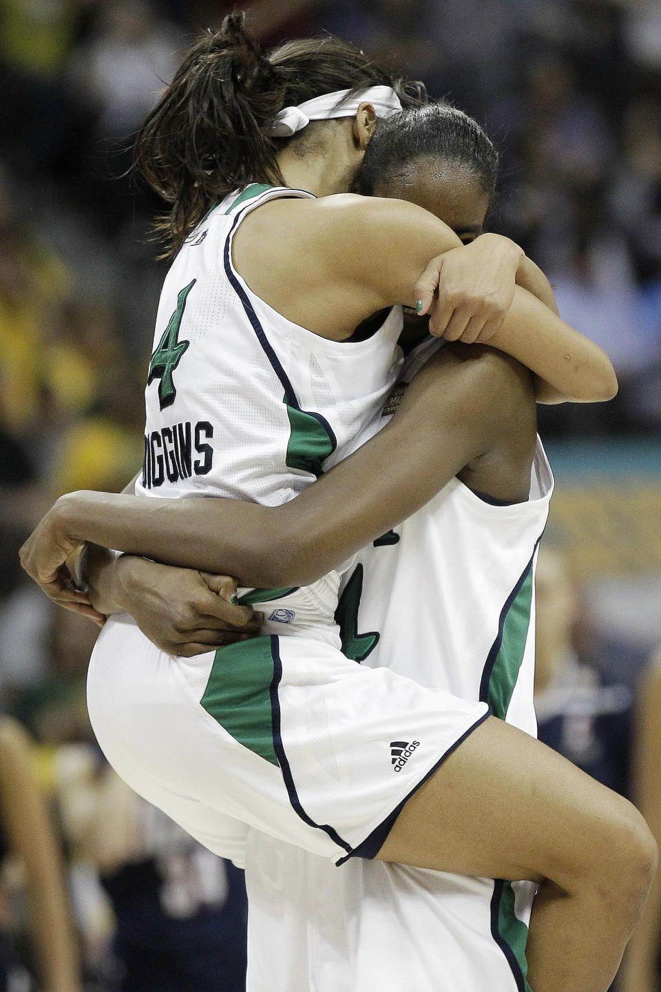 Notre Dame guard Skylar Diggins (4) and Notre Dame forward Devereaux Peters (14) embrace after overtime in the NCAA women's Final Four semifinal college basketball game against Connecticut, in Denver, Sunday, April 1, 2012. Notre Dame won 83-75. (AP Photo/Eric Gay)