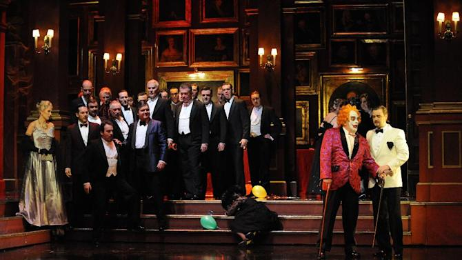 """This Sept. 15, 2010 photo released by Opera Australia shows the cast of Opera Australia's """"Rigoletto,"""" in Sydney. The first of Giuseppe Verdi's three great middle period triumphs has been shifted before to New York's Little Italy, Federico Fellini's Rome, modern-day Hollywood and even the Oval Office. Now it will take place amid dazzling Sin City lights and not in the Renaissance Palazzo Ducale when Michael Mayer's version of the 162-year-old classic opens Monday night. (AP Photo/Opera Australia, Branco Gaica)"""
