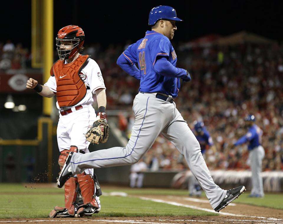 New York Mets' Aaron Harang (44) scores past Cincinnati Reds catcher Ryan Hanigan on a sacrifice fly by Lucas Duda in the third inning of a baseball game, Monday, Sept. 23, 2013, in Cincinnati. (AP Photo/Al Behrman)