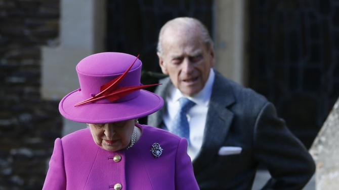 Britain's Queen Elizabeth and Prince Philip leave a Christmas Day morning service at the church on the Sandringham Estate in Norfolk