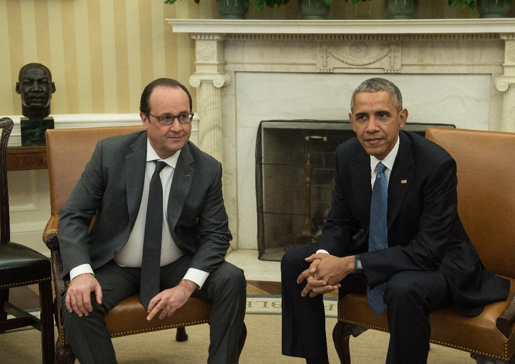 Hollande seeks 'binding' climate pact with promises on cash