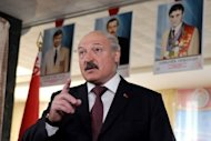 Belarus President Alexander Lukashenko speaks to journalists after voting in Minsk. Belarus on Monday boasted of a massive turnout in parliamentary polls won by supporters of Lukashenko but the opposition ridiculed the results as brazenly rigged