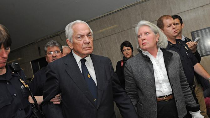 FILE - Anthony Marshall, Brooke Astor's 85-year-old son, center, exits Manhattan State Supreme Court with wife Charlene, right, in this Thursday, Oct. 8, 2009 file photo taken in New York. Marshall, the 89-year-old heir to the famous Astor fortune is hoping to stay out of a New York prison. He had been due to surrender Monday June 17, 2013 to serve one to three years. He was convicted of looting his mother's money as her mind failed. (AP Photo/ Louis Lanzano)