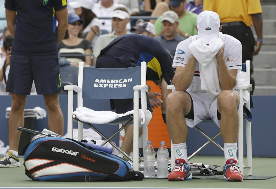 Andy Roddick lowers his head between games against Argentina's Juan Martin Del Potro in the quarterfinals during the 2012 US Open tennis tournament,  Wednesday, Sept. 5, 2012, in New York. (AP Photo/Darron Cummings)
