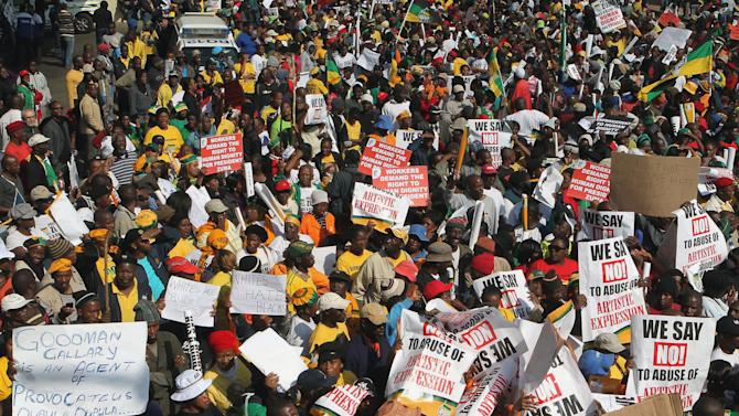 South African ruling party supporters sing during their protest in Johannesburg, South Africa on Tuesday May 29, 2012. The African National Congress and its alliance partners march to the Goodman Gallery to protest against a now-defaced painting depicting President Jacob Zuma. (AP Photo/Themba Hadebe)