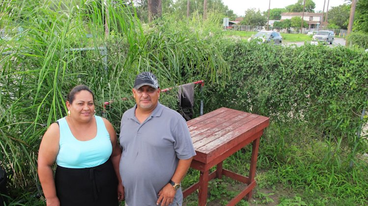 In this Sept. 18, 2013, photo Sigifredo Saldana Iracheta, right and his wife Laura Saldana pose for a photo outside his sister's home in Brownsville, Texas. After a years-long fight, the 5th U.S. Circuit Court of Appeals declared that Sigifredo Saldana had been a U.S. citizen since birth. In ruling for Saldana, the court dismissed the government's explanation of the error saying it had been perpetuated and uncorrected since 1978. (AP Photo/Christopher Sherman)