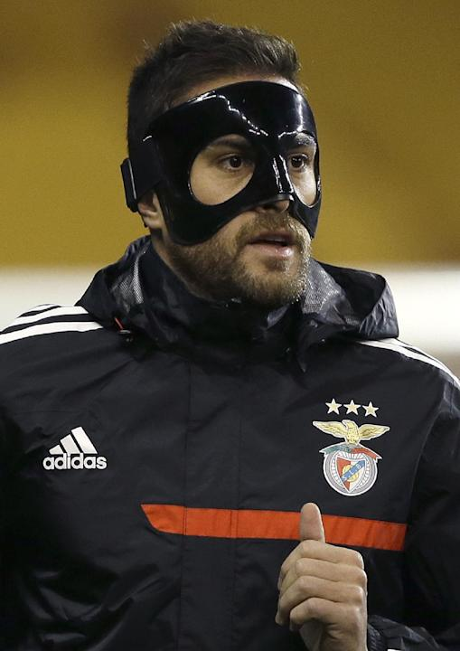 Benfica's player Jardel wears a protective mask during a training session at White Hart Lane stadium in London Wednesday, March 12, 2014. Benfica will play Tottenham in a Europa League round of 16