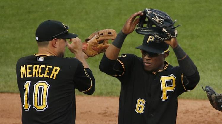 Pittsburgh Pirates' Jordy Mercer (10) celebrates with Starling Marte after getting a 3-2 win over the Cincinnati Reds in a baseball game in Pittsburgh Saturday, Aug. 30, 2014. (AP Photo/Gene J. Puskar)