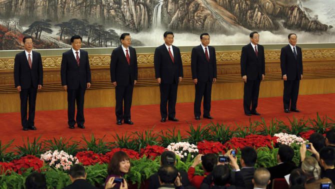 From left, members of the new Politburo Standing Committee Zhang Gaoli, Liu Yunshan, Zhang Dejiang, Xi Jinping, Li Keqiang, Yu Zhengsheng and Wang Qishan meet journalists in Beijing's Great Hall of the People Thursday Nov. 15, 2012. The seven-member Standing Committee, the inner circle of Chinese political power, was paraded in front of assembled media on the first day following the end of the 18th Communist Party Congress. (AP Photo/Vincent Yu)