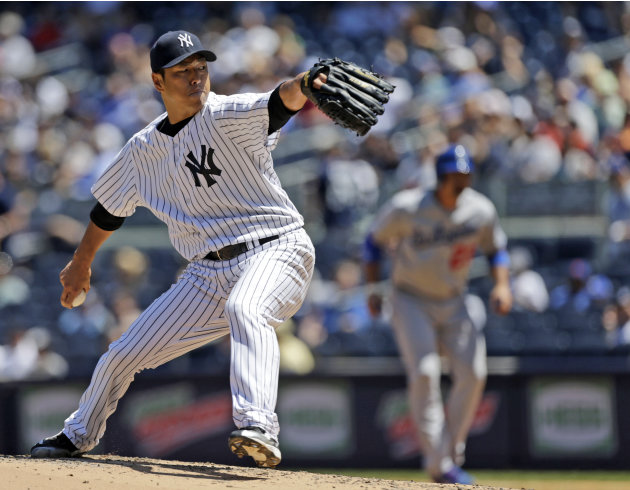 New York Yankees starting pitcher Hiroki Kuroda, of Japan, delivers during the fourth inning of a baseball game against the Los Angeles Dodgers Wednesday, June 19, 2013, in New York. (AP Photo/Kathy W