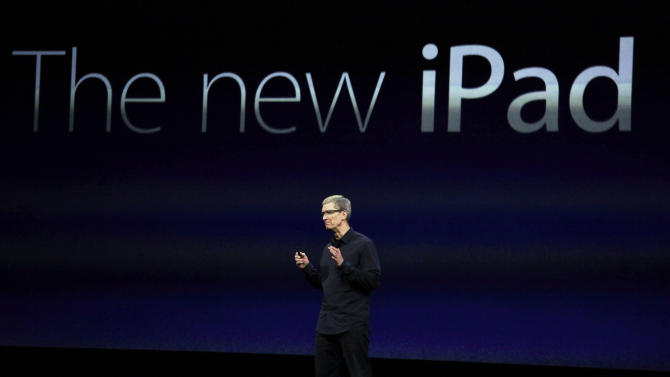 FILE -In this Wednesday, March 7, 2012, file photo, Apple CEO Tim Cook announces a new iPad during an Apple announcement in San Francisco. Those who follow Apple believe they have figured out most of the particulars of a smaller iPad expected to be revealed on Tuesday, Oct. 23, 2012. Apple hasn't said anything about the device, but the veil of secrecy it throws over unreleased products has been a see-through affair this year. Most of the details of the iPhone 5 were known well in advance of its launch a month ago. (AP Photo/Paul Sakuma, File)