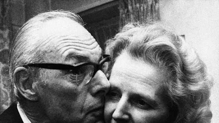 FILE - In a Feb. 4, 1975 file photo, Margaret Thatcher gets a kiss  from her husband Denis in London, Feb. 4, 1975, after she had come out on top with 130 votes in the first round of the election for the Conservative party leadership. Thatchers former spokesman, Tim Bell, said that the former British Prime Minister Margaret Thatcher had died Monday morning, April 8, 2013, of a stroke.  She was 87 years old. (AP Photo/File)