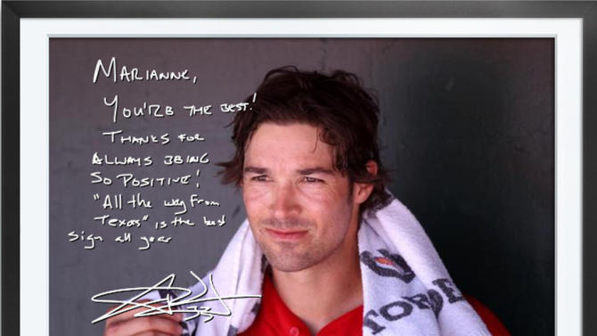 This undated photo provided by Egraphs shows an Egraph signed by Los Angeles Angels pitcher C.J. Wilson. Egraphs, launched at the All-Star break, is a technological breakthrough that offers an autographed digital picture with a handwritten note and a personalized audio message for $50. (AP Photo/Egraphs)