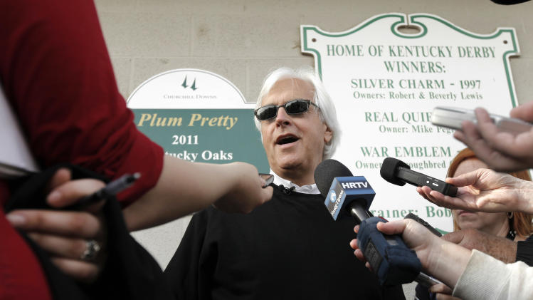 Trainer Bob Baffert talks to the media after Kentucky Derby hopeful Liaison worked out at Churchill Downs in Louisville, Ky., Monday, April 30, 2012.  The Kentucky Derby horse race is scheduled for Saturday, May 5. (AP Photo/Charlie Riedel)