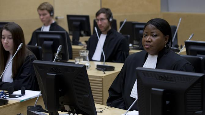 Public Prosecutor Fatou Bensouda, right, is seen at the start of the initial appearance of Rwandan-born warlord Bosco Ntaganda before judges of the International Criminal Court in The Hague, Netherlands, Tuesday March 26, 2013, Ntaganda facing charges including murder, rape pillaging and using child soldiers in eastern Congo after his surprise surrender. Ntaganda had been one of the court's longest-sought fugitives until he unexpectedly became the first suspect to voluntarily turn himself in by seeking refuge last week at the U.S. Embassy in the Rwandan capital, Kigali. Ntaganda allegedly led rebels who terrorized eastern Congo in brutal tribal fighting from 2002 till 2003. (AP Photo/Peter Dejong, Pool)