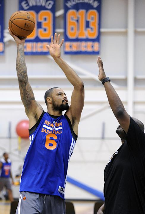 New York Knicks' Tyson Chandler puts up a shot as he works against coach LaSalle Thompson, right, at the NBA basketball teams training camp Tuesday, Oct. 1, 2013, in Greenburgh, N.Y
