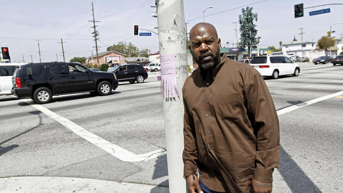 On April 19, 2012, Henry Keith Watson poses for a portrait on the corner of Florence and Normandie in Los Angeles, where Watson and others dragged truck driver Reginald Denny from his cab and beat him severely on the first night of rioting.  The acquittal of four police officers in the videotaped beating of King sparked rioting that spread across the city and into neighboring suburbs. Cars were demolished and homes and businesses were burned. Before order was restored, 55 people were dead, 2,300 injured and more than 1,500 buildings were damaged or destroyed.(  (AP Photo/Matt Sayles)
