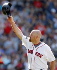 Boston Red Sox's Kevin Youkilis tips his helmet as he comes off the field after hitting a triple and being replaced with a pinch runner in the seventh inning of a baseball game against the Atlanta Braves in Boston, Sunday, June 24, 2012. (AP Photo/Michael Dwyer)