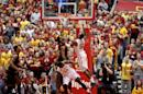 Iowa State guard DeAndre Kane puts up a shot over Oklahoma State guard/forward Brian Williams with less 30 second to go during overtime of an NCAA college basketball game in Ames, Iowa, Saturday, March 8, 2014. Kane made the basket and Iowa State won the game 85-81. (AP Photo/Justin Hayworth)