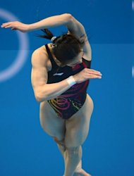China&#39;s Wu Minxia competes in the final of the women&#39;s 3m springboard diving event at the London 2012 Olympic Games in London. She won gold