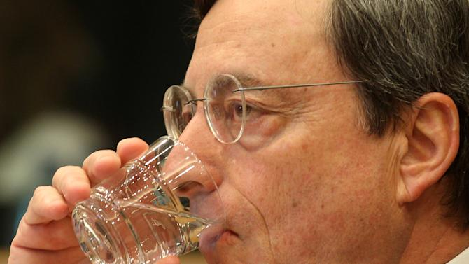President of the European Central Bank Mario Draghi drinks as he reports to the Economic Committee, in capacity as the head of the European Systemic Risk Board, at the European Parliament in Brussels, Thursday, May 31, 2012. (AP Photo/Yves Logghe)