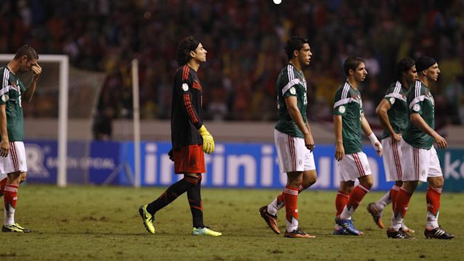 Players of Mexico leave the field of play after their 1-2 lost against Costa Rica during a 2014 World Cup qualifying soccer match in San Jose, Costa Rica, Tuesday, Oct. 15, 2013. From left to right, , Christian Gimenez, Carlos Pena, Fernando Arce, Raul Jimenez, Guillermo Ochoa and Miguel Layun.  Despite it's lost Mexico will play New Zealand for a spot in next year's World Cup