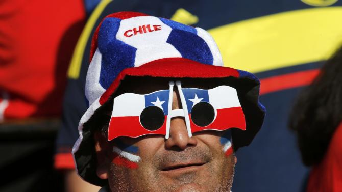 A Chile fan waits ahead of the team's Copa America 2015 final soccer match against Argentina at the National Stadium in Santiago