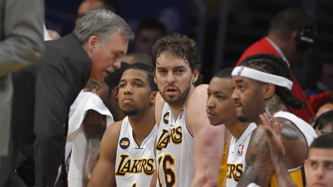Los Angeles Lakers head coach Mike D'Antoni, left, talks to Darius Morris, second from left, Pau Gasol, third from left, of Spain, Andrew Goudelock, second from right, and Jordan Hill during the second half in Game 4 of a first-round NBA basketball playoff series against the San Antonio Spurs, Sunday, April 28, 2013, in Los Angeles. The Spurs won 103-82. (AP Photo/Mark J. Terrill)