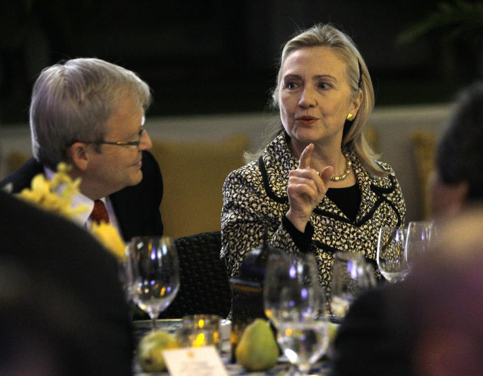 U.S. Secretary of State Hillary Clinton, right, talks with Australian Foreign Minister Kevin Rudd during a dinner with APEC ministers at the Asia-Pacific Economic Cooperation summit Thursday, Nov. 10, 2011, in Honolulu. (AP Photo/Andres Leighton)