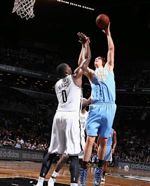 Nuggets blow out Nets for 7th straight victory