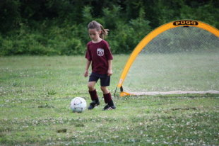 My daugheter playing soccer.