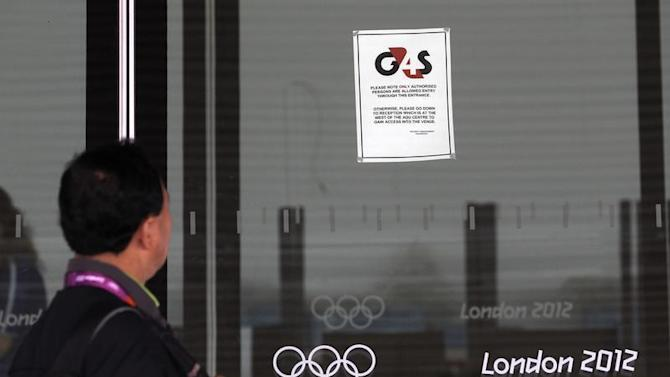 A visitor to the Olympic Park reads a 4GS notice stuck to a window at the Aquatics centre, in the Olympic Park, in Stratford