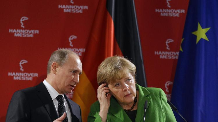 Putin, Merkel air differences on NGOs