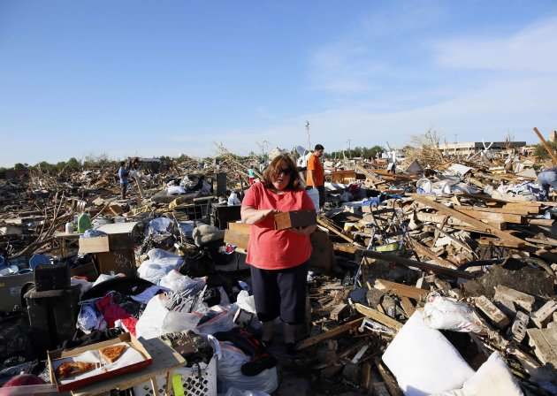 Kelli Kannady weeps after finding a box of photographs of her late husband in the rubble near what was her home in Moore
