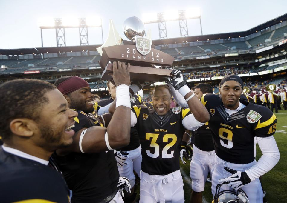 Arizona State players lift the winner's trophy after a 62-28 win over Navy during the Fight Hunger Bowl NCAA college football game in San Francisco, Saturday, Dec. 29, 2012. (AP Photo/Marcio Jose Sanchez)