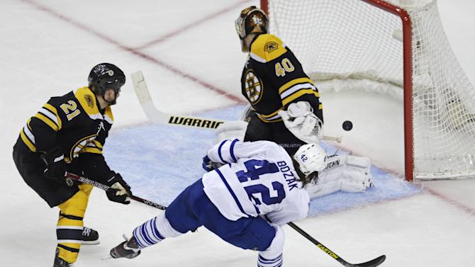 Toronto Maple Leafs center Tyler Bozak (42) beats Boston Bruins goalie Tuukka Rask (40) on a goal during the second period in Game 5 of an NHL hockey Stanley Cup playoff series in Boston, Friday, May 10, 2013. At left is Bruins' Andrew Ference (21). (AP Photo/Charles Krupa)