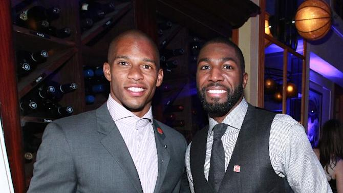IMAGE DISTRIBUTED FOR NFLPA -Victor Cruz, left, of the New York Giants and Greg Jennings of the Green Bay Packers are seen at the VIP Reception hosted by the NFLPA, on Thursday, Jan. 31, 2013 in New Orleans. (Photo by Dario Cantatore/Invision for NFLPA/AP Images)