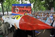 "South Korean conservative activists carry a mock missile and a North Korean flag with a slogan reading ""Down with North Korea"" at a rally in Seoul in 2009. North Korea said Saturday it has no plans ""at present"" to conduct a nuclear test despite what it called South Korean attempts to provoke the situation"
