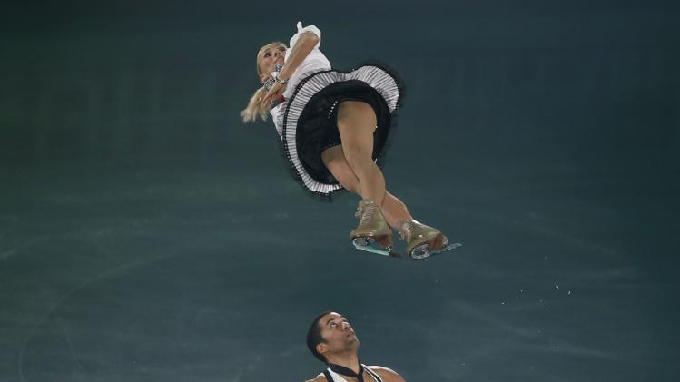 Aliona Savchenko and Robin Szolkowy of Germany perform during the gala exhibition at the ISU Grand Prix of Figure Skating Final in Fukuoka, Japan