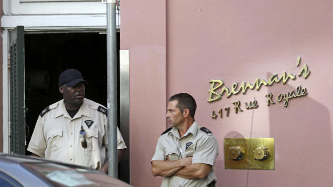 """FILE - In this June 28, 2013, file photo, security guards stand in front of the now-closed Brennan's Restaurant in New Orleans. Brennan's Restaurant: """"A New Orleans Tradition Since 1946,"""" as the website brags, is closed, the latest shoe to fall in 40 years of headline-grabbing family discord and costly litigation over matters of control, money and use of the family name at some of the establishments that trace their lineage to Owen Sr. (AP Photo/Gerald Herbert, File)"""