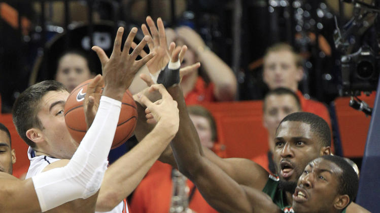 No. 12 Virginia runs away from Miami, 65-40