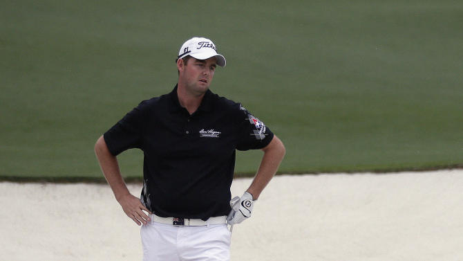 Marc Leishman, of Australia, hits out of a bunker on the second hole during the fourth round of the Masters golf tournament Sunday, April 14, 2013, in Augusta, Ga. (AP Photo/David Goldman)